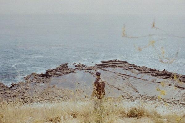 Palos Verde, California, USA  A young man off the coast of California. Shot on 35mm Film Pentax ME Super.