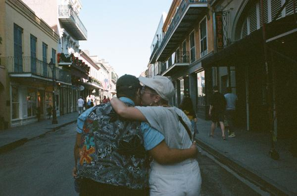 New Orleans, Louisiana, USA  A young couple embrace in the French Quarter in New Orleans. Shot on 35mm Film Pentax ME Super.