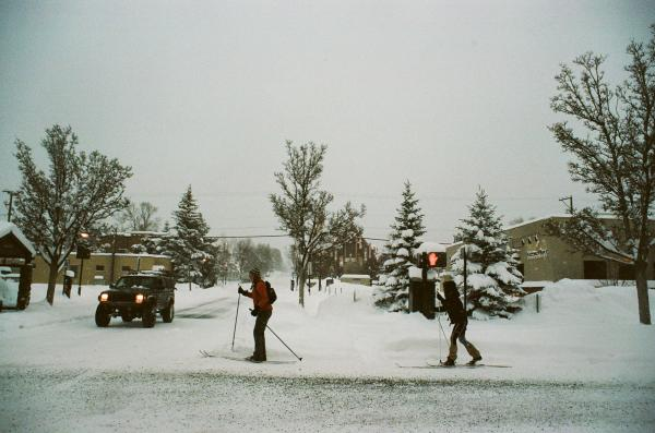 Flagstaff, Arizona, USA  Flagstaff residents ski through downtown during a record breaking snowfall, February 2019. This a new one-day snowfall record set at the Flagstaff Airport with 35.9 inches of snow in 24 hours. Shot on 35mm film on a Pentax ME Super.