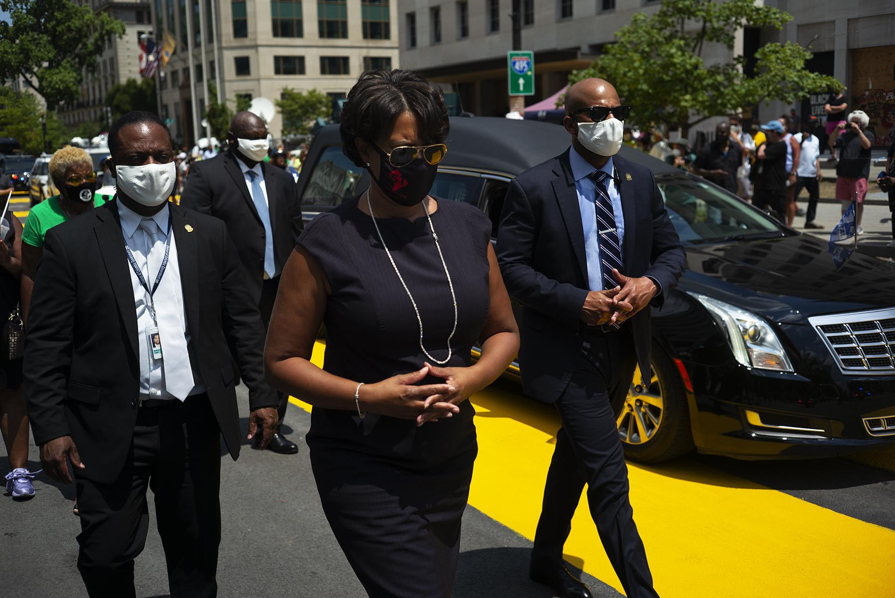 Washington D.C May Muriel Bowser walks alongside of the hearse carrying the body of John Lewis as it passes through Black Lives Matter Plaza on July 27, 2020.