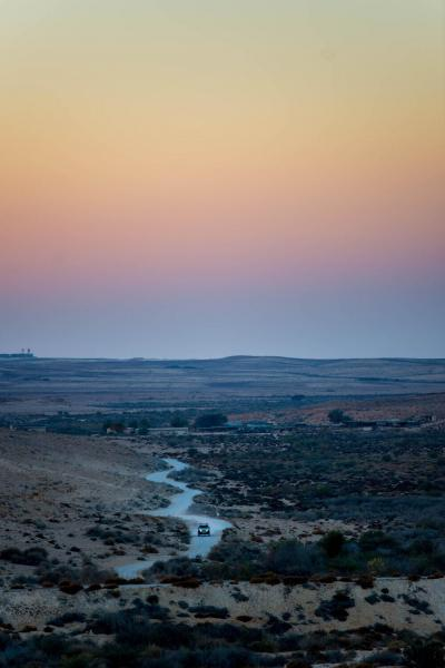 Ezuz, Israel  Twilight falls in Ezuz a small community settlement in the Negev desert, Israel. Named for Nahal Ezuz, a dry riverbed, it is located south of Nitzana. Ezuz is under the jurisdiction of the Ramat HaNegev Regional Council.