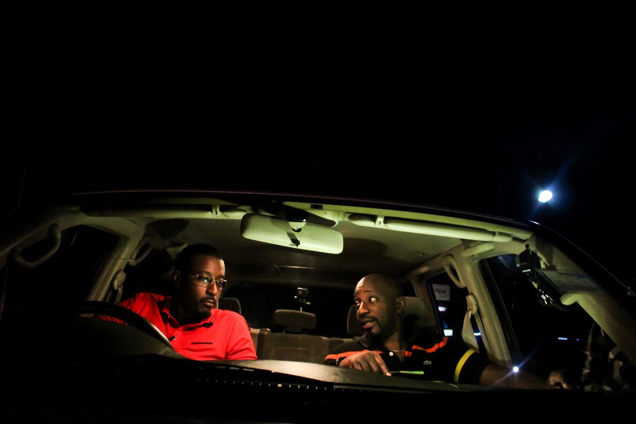 Marcus Kwikiriza and Gaetano Kagwa of the NBS show 'Another Round' get into character for a scene set in a car, filmed along the new Entebbe Expressway.