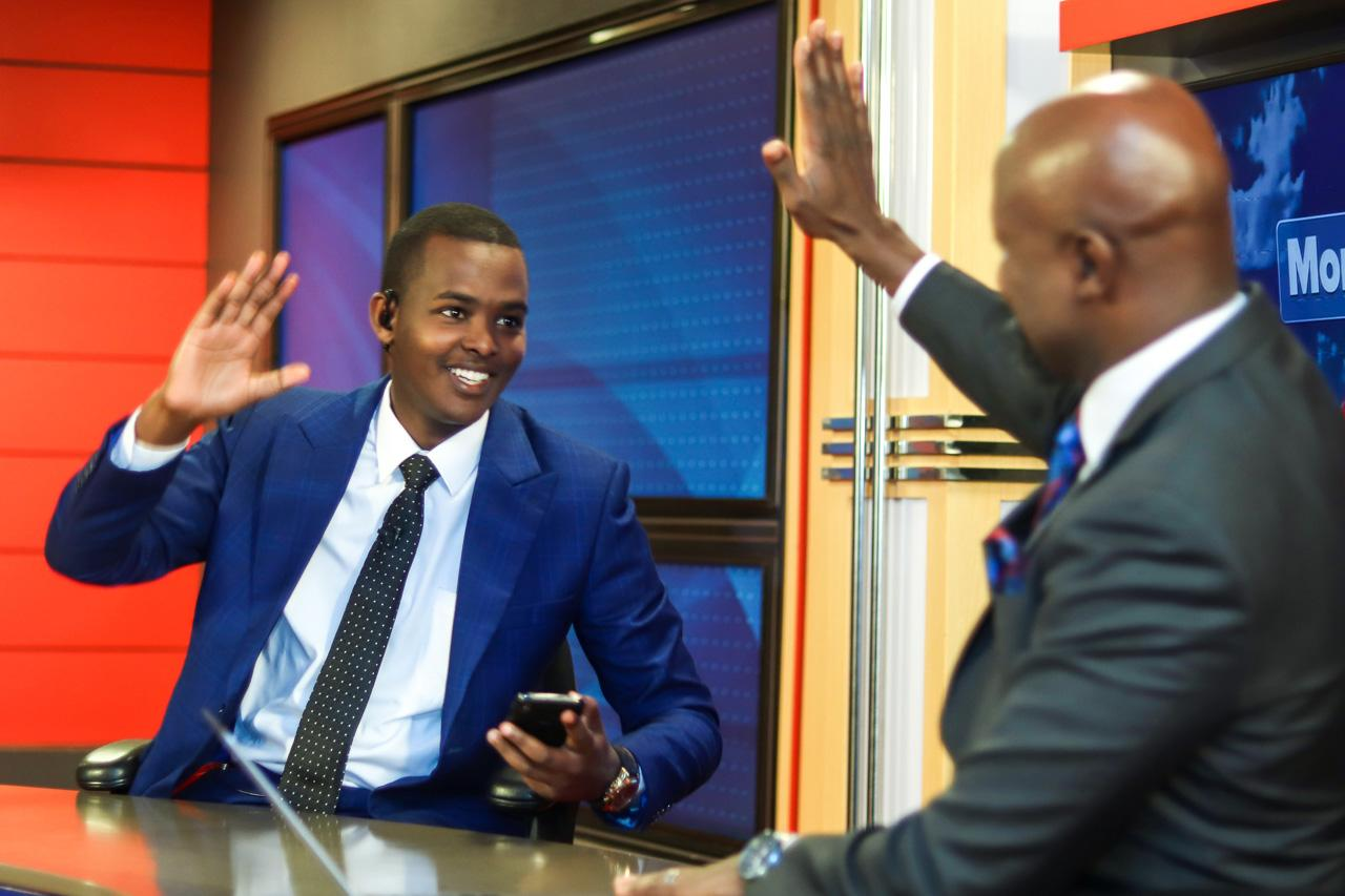 Canary Mugume (left) and Samson Kasumba high-five on Morning Breeze after a funny comment made by Samson, who anchors the show.