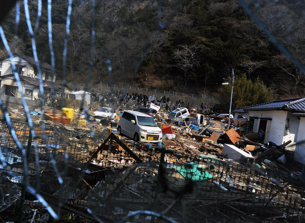 "A view of the devastated residential area and cemetery of ""Jion-in""  from Minato elementary school evacuation center in Ishinomaki, Miyagi prefecture."