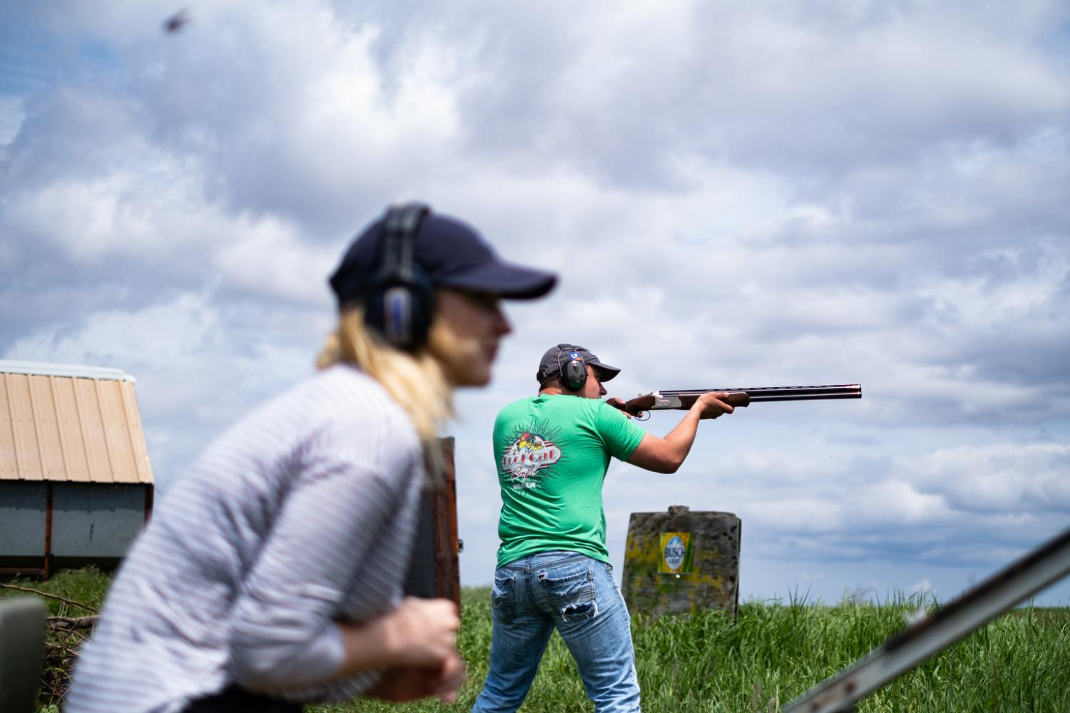 My brother and Emily shooting clay pigeons.