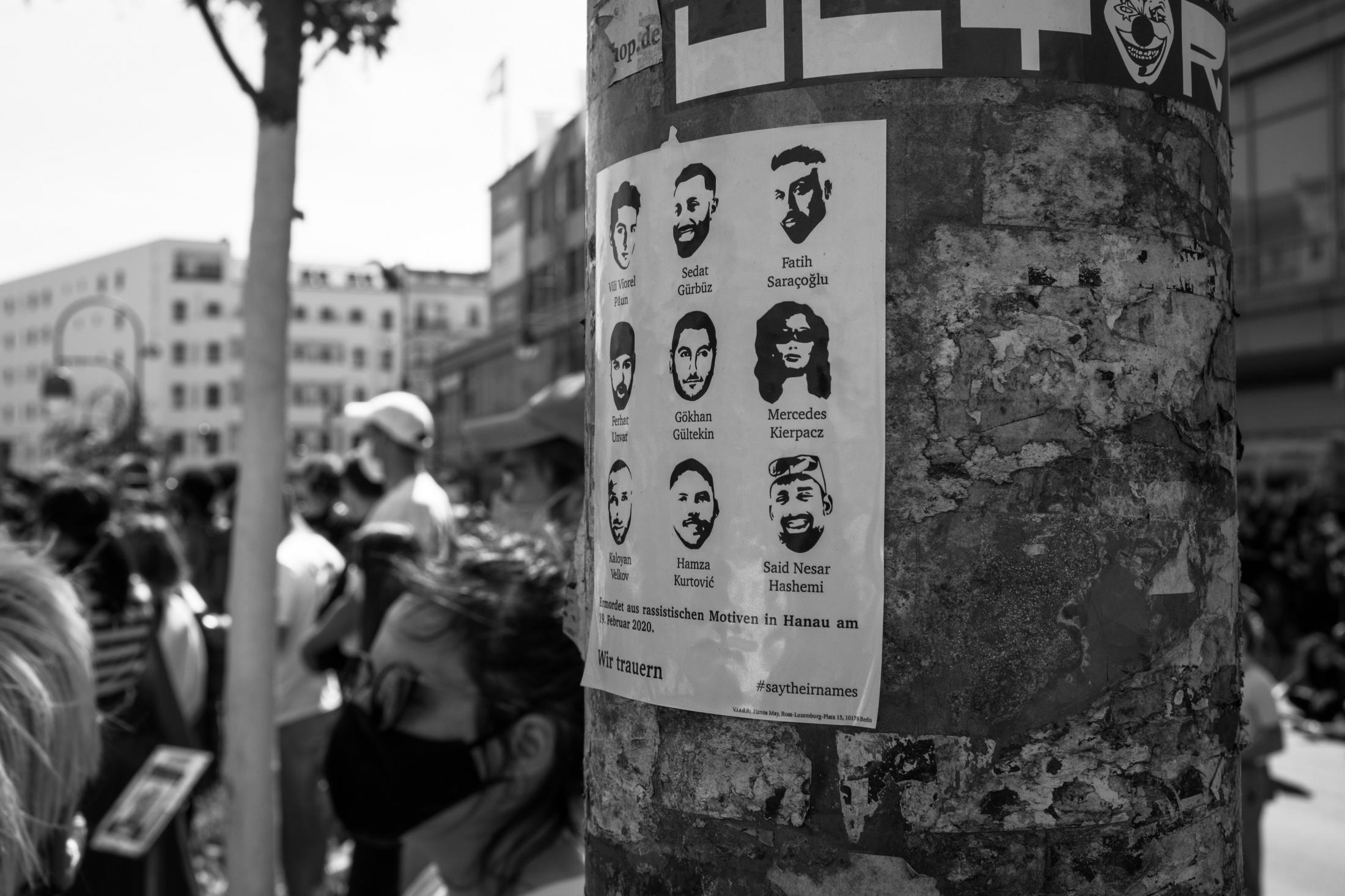 A sticker naming the nine victims of the racist terrorist attack of Hanau is seen on a lamp post at the Black Lives Matter demonstration on Hermannplatz. Berlin, May 31, 2020.