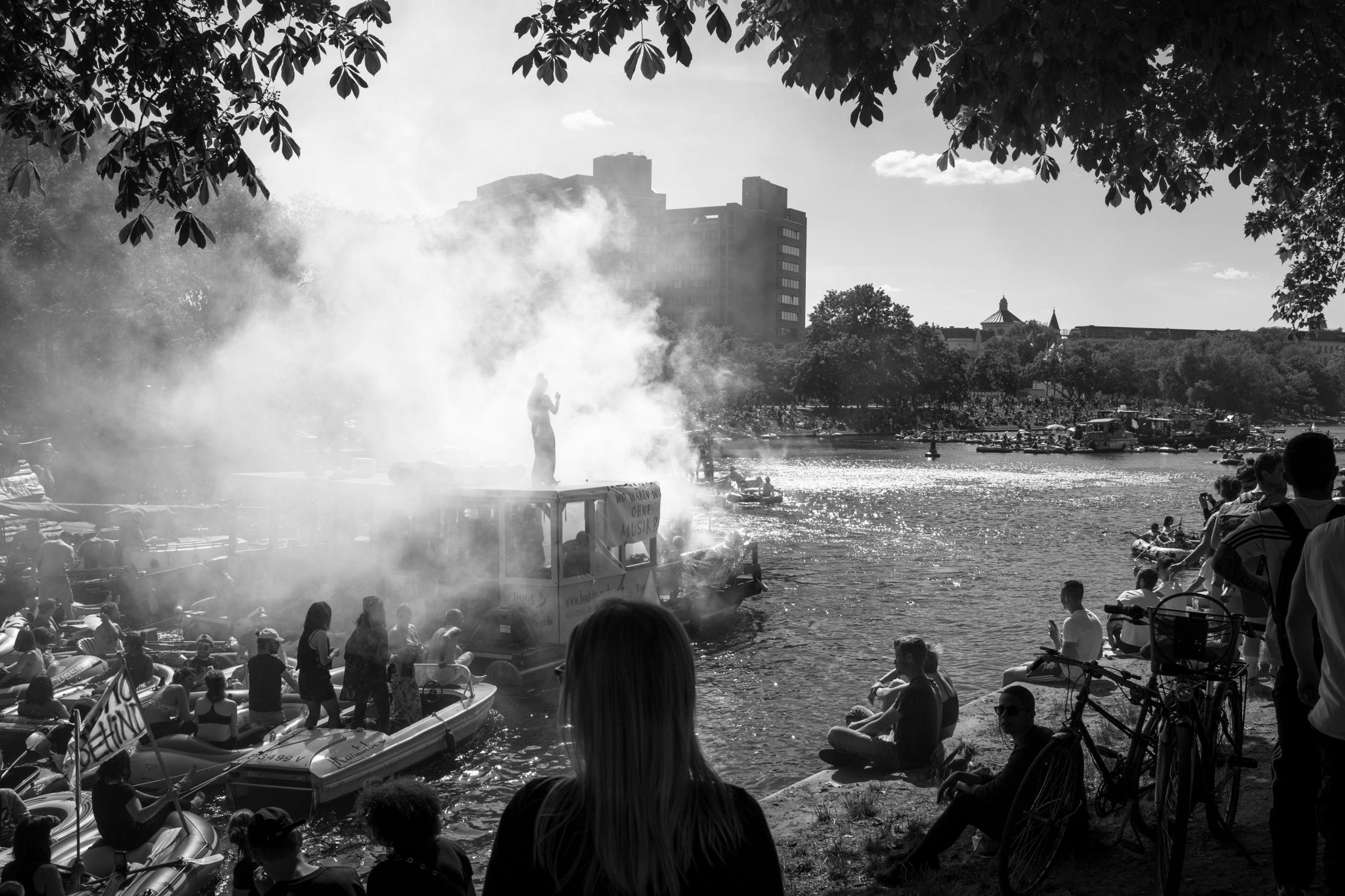 "A water demonstration to ""save rave culture"" (#RavekulturRetten) arrives at the Urbanhafen area of the Berlin Landwehrkanal. In the midst of the Corona epidemic, an estimated 5,000 attendees turned the shore right in front of a hospital (pictured in the background) into a rave party that had to be broken up by police. The event caused a countrywide uproar and the organizers apologized publicly. Berlin, May 31, 2020."