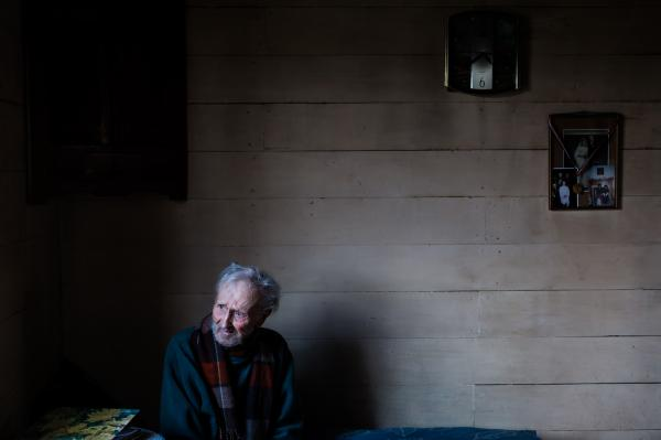 Hugo, the oldest man in the town of Las Cascadas, spends time sitting on his couch watching how the wind moves the trees on his farm on a cold winter day on July 25th, 2016.
