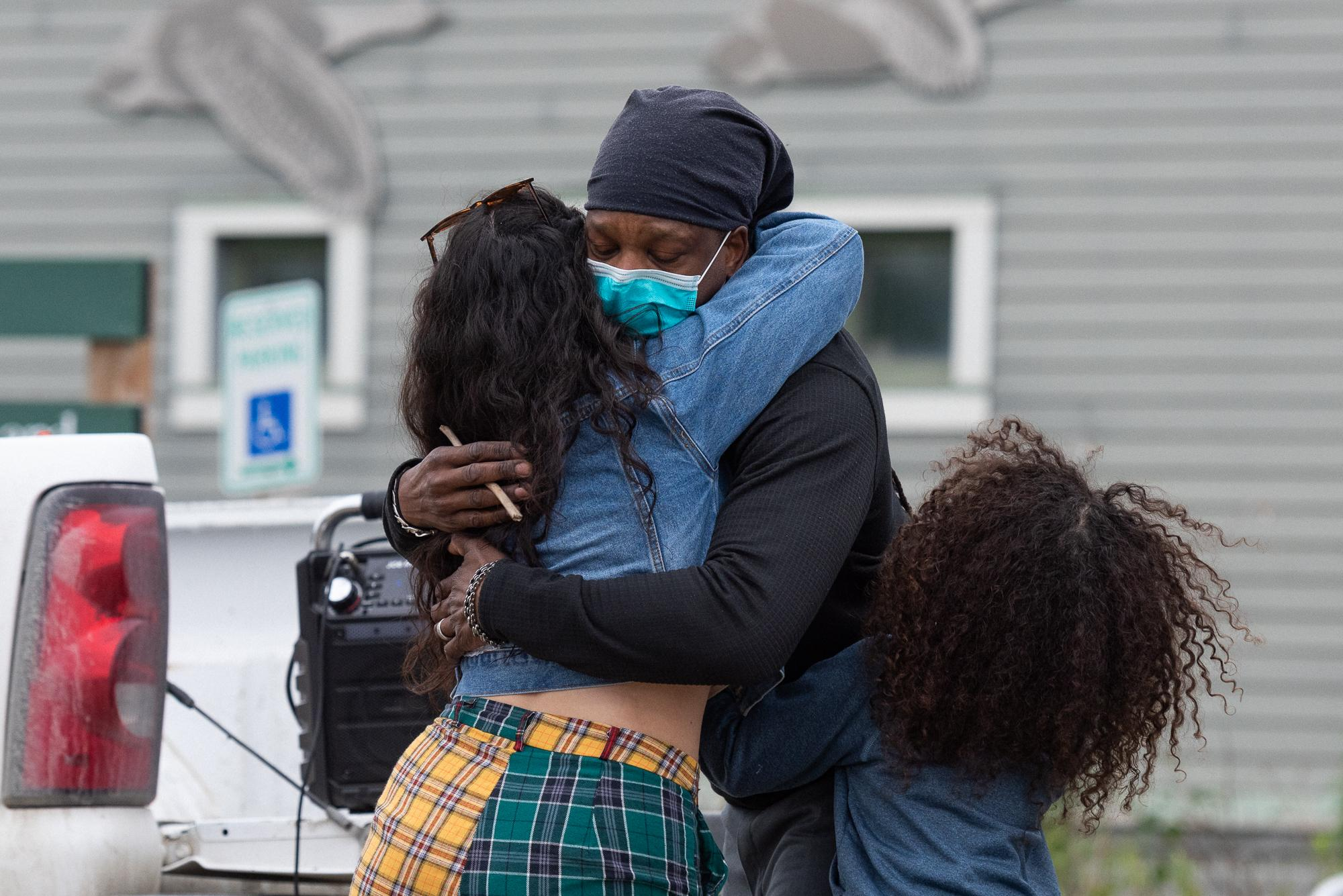 Lonnie Holley Sr. is embraced by Alize Mccabe and his neice after giving an emotional speech at the Black Lives Matter protest on June 5, 2020 in Bethel, Alaska.