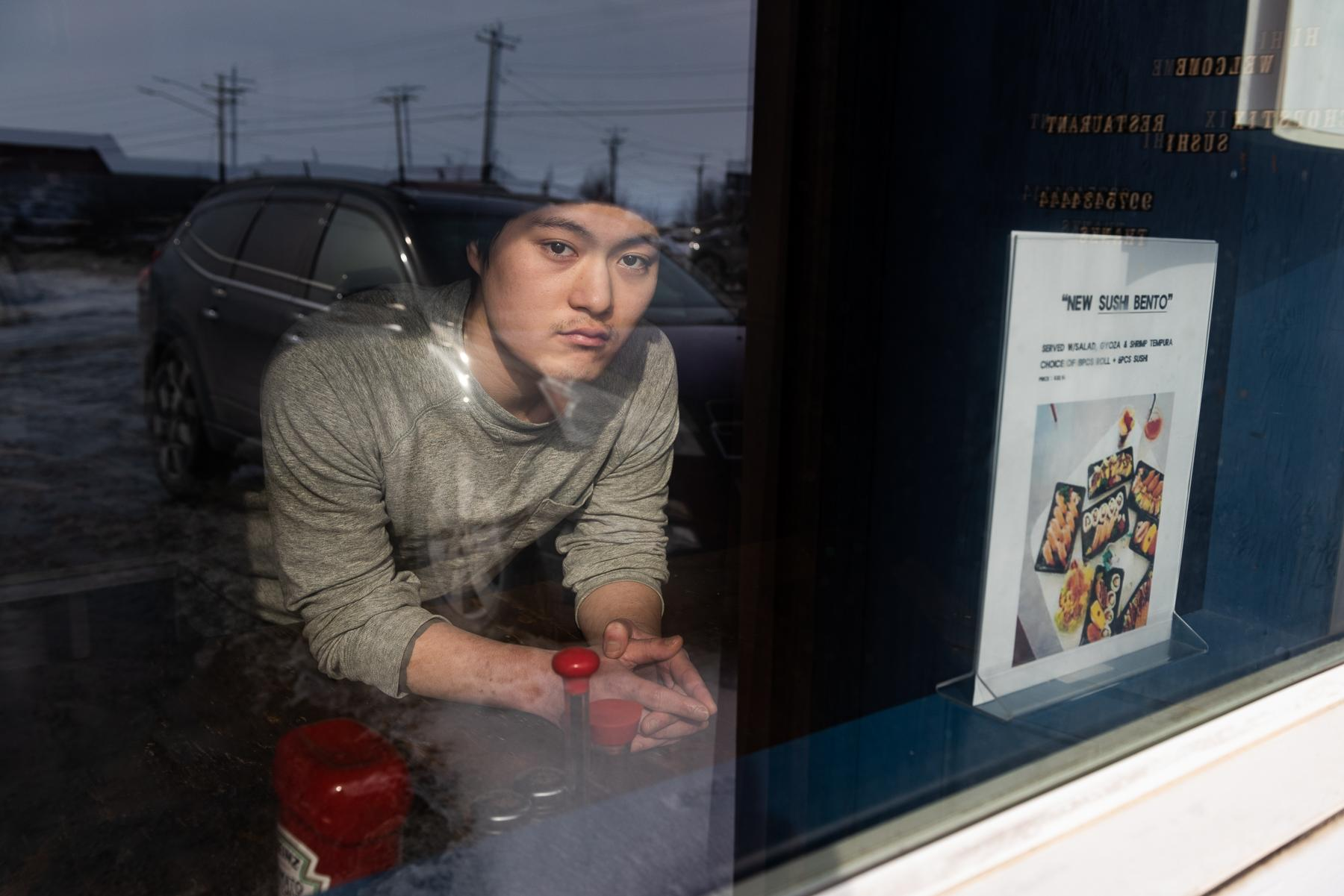 Alex Kim, owner of Chopstix Sushi Restaurant, says he may have to return to Korea if business doesn't pick-up. Bethel restaurants are in peril following mandates that restrict business to delivery and pick-up orders amidst the COVID-19 outbreak. March 31, 2020 in Bethel, Alaska.