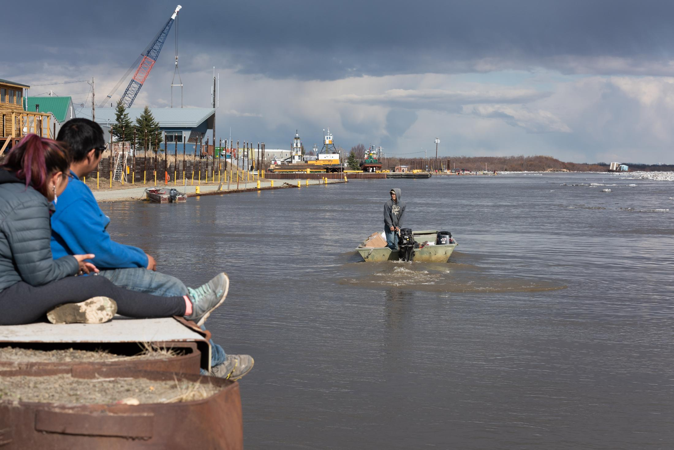 Phillip Wilson leaves the Bethel seawall in search of a break in the ice flow where he can cross the Kuskokwim and head downriver to Napaskiak on May 6, 2020.