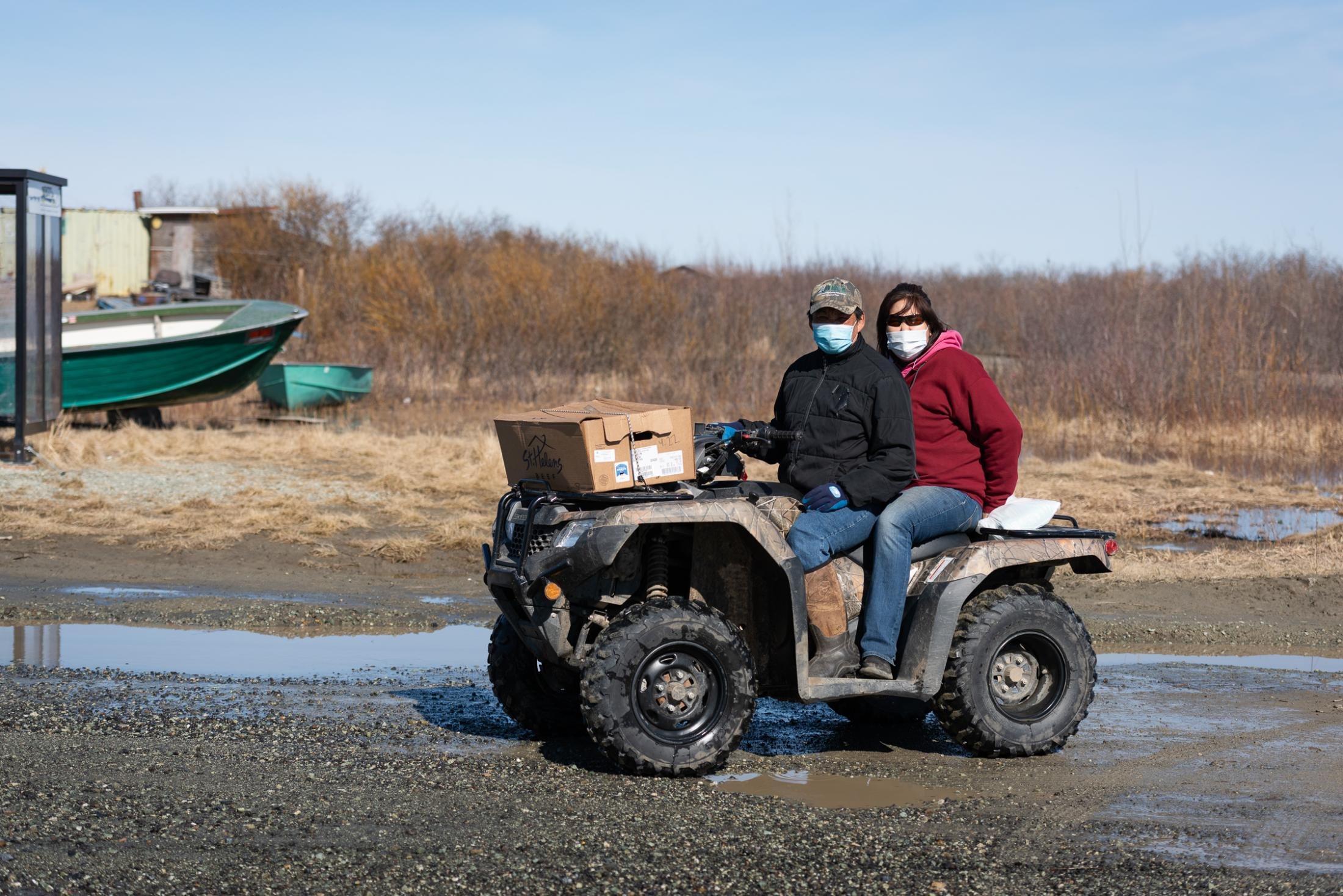 Bethel residents head out to check on elderly relatives amidst the 2020 Kuskokwim River break-up flood and coronavirus pandemic on May 6, 2020.