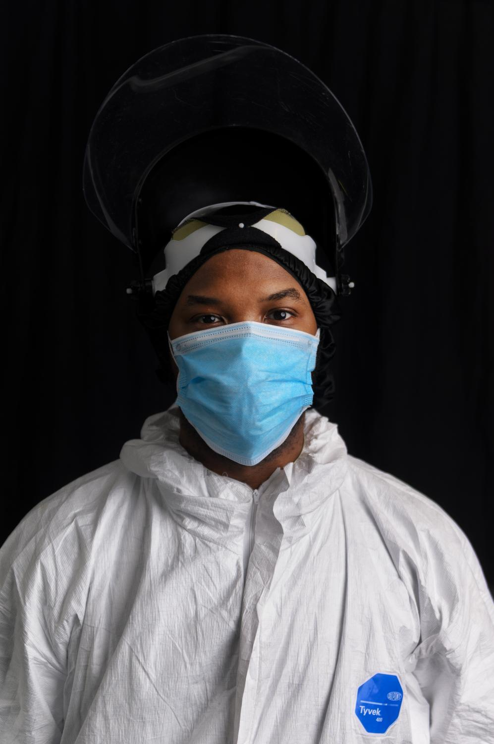 Shawn McArthur, 31, from Staten Island, NY poses for a portrait inside the COVID unit at Clove Lakes Nursing Home in Staten Island, NY where he works as a ceertified nursing assistant.