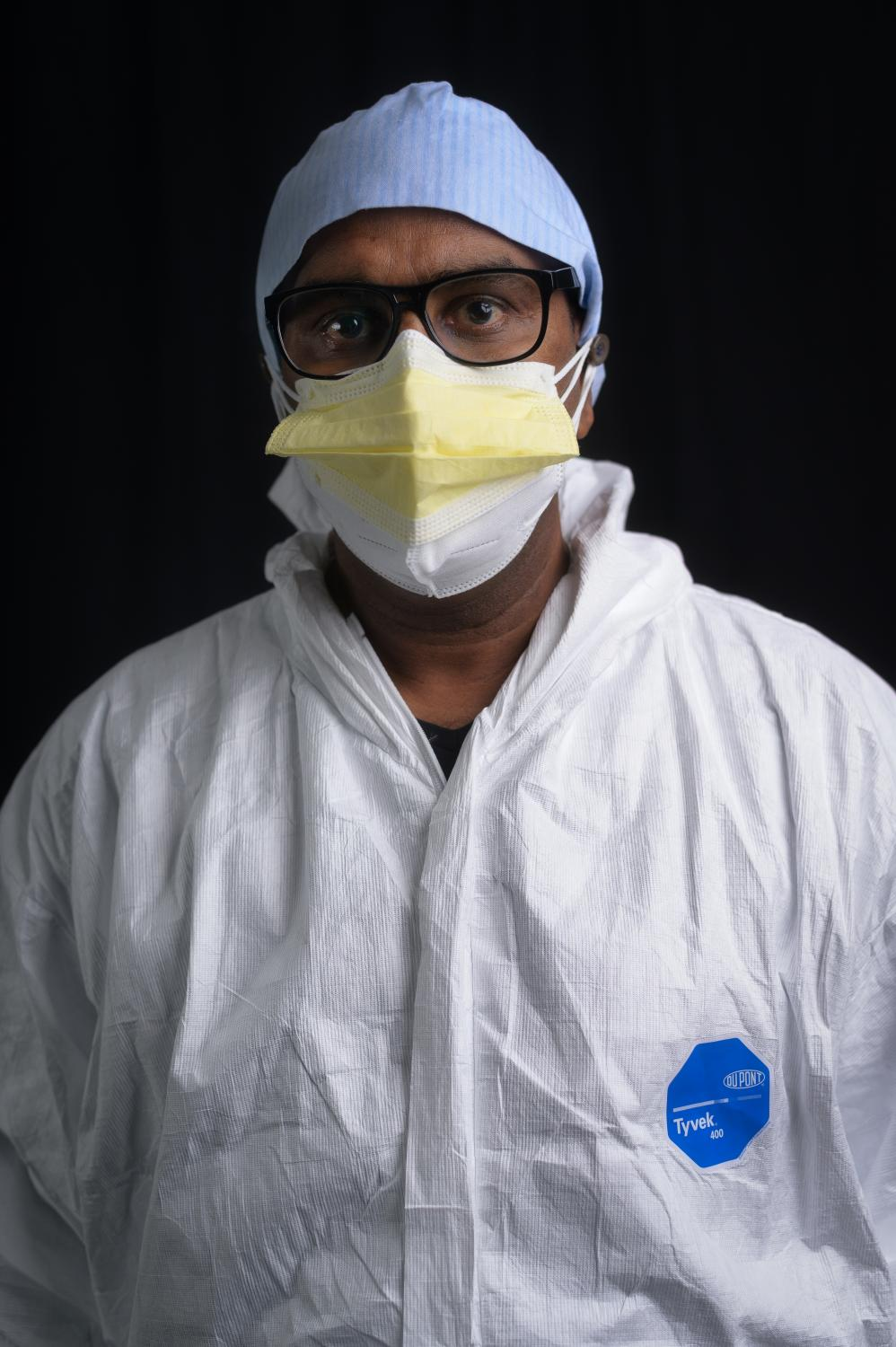 W. Costa, 50, originally from Sri Lanka, poses for a portrait inside the COVID unit at Clove Lakes Nursing Home in Staten Island, NY where he works as acertified nursing assistant