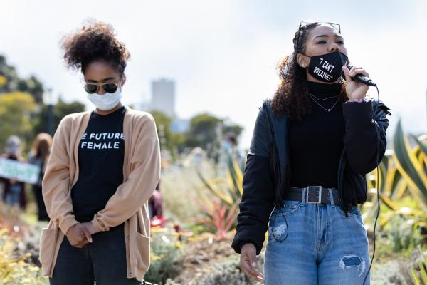 Tiana Day, 17, (right) and Zoe Taylor, 18, speak to the audience during the Women in Solidarity for Justice and Equality protest at Mission Dolores Park on Friday, June 12, 2020, in San Francisco, Calif.