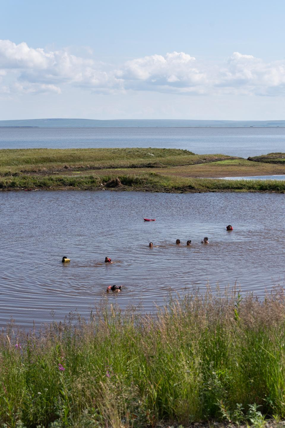 The pond next to the airport turns into a swimming hole on hot summer days. The pond used to hold the communities drinking water until the Ninglick River flooded contaminating the water. July 16, 2020 in Newtok, Alaska.