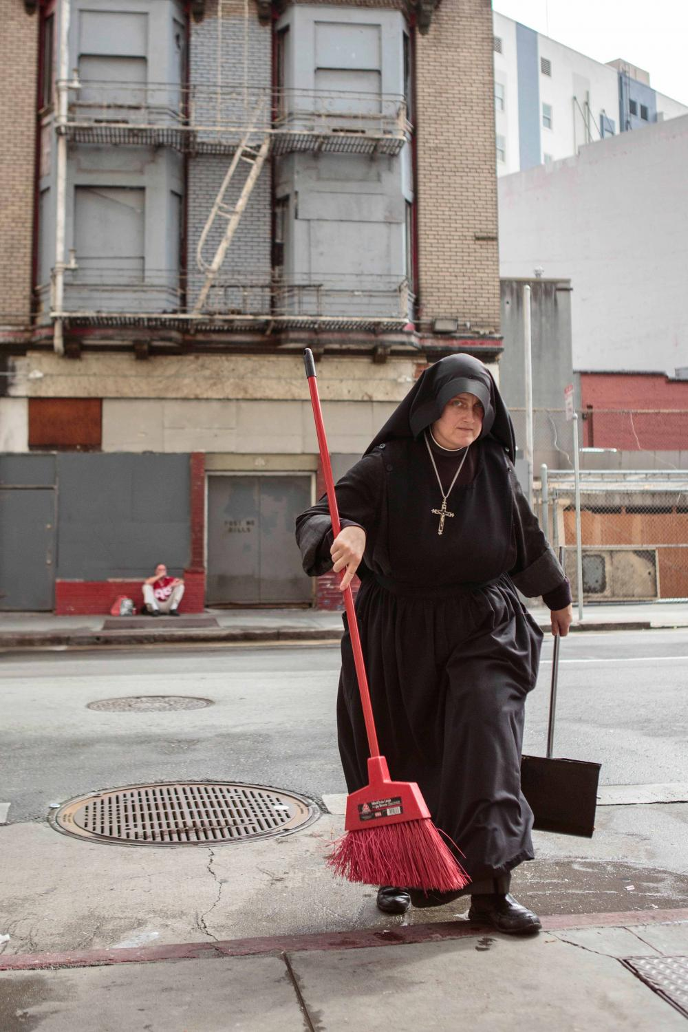 Sister Mary Benedicte approaches to enter the Fraternite Notre Dame Mary of Nazareth Soup Kitchen on Turk Street after sweeping the street on Monday, September 29, 2014, in San Francisco, California.