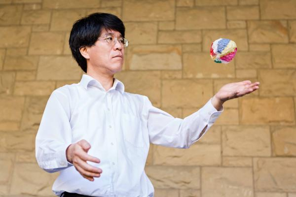 Japanese mathematician Tadashi Tokieda explores the physics behind why the Kamifusen, a Japanese paper balloon, can be inflated when it's batted around on Tuesday, November 6, 2018, at Stanford University in Stanford, California. Photo by Constanza Hevia H.