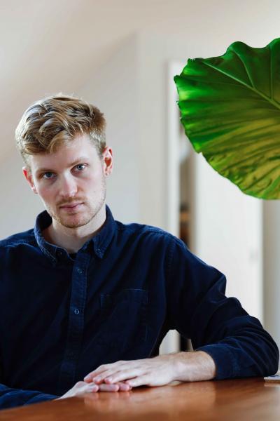 Award-winning documentary filmmaker Luke Lorentzen poses for a portrait at his home on Monday, Nov. 18, 2019, in San Francisco, Calif.