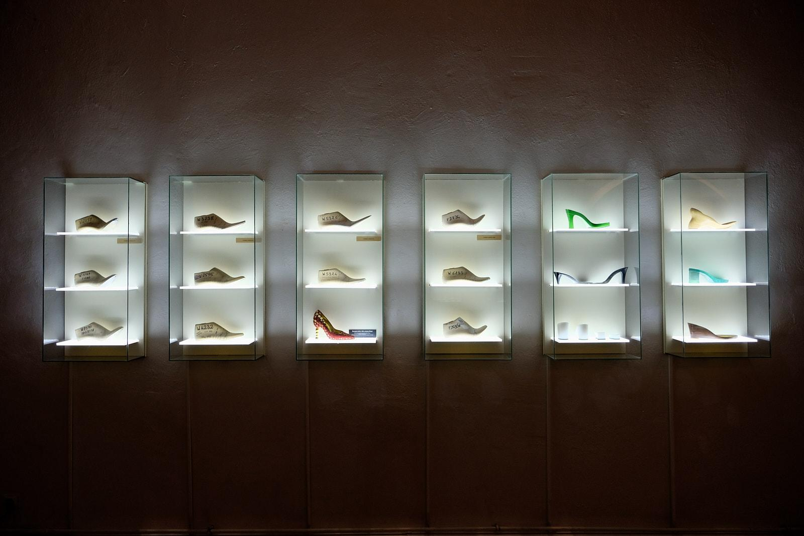 A window with different shapes of shoes in the Musee de la Chaussure in Romans