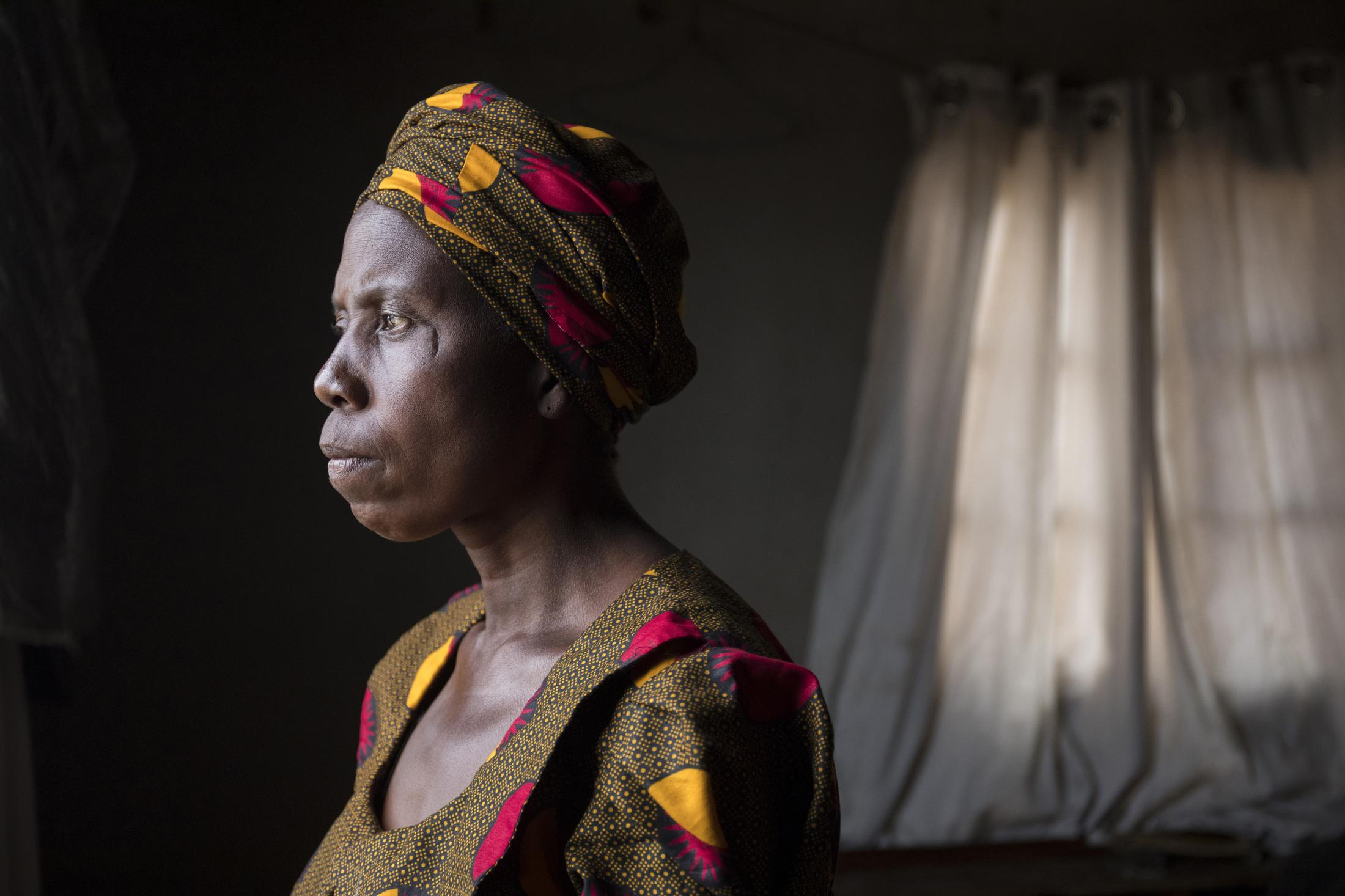 """A portrait of Sifiso at her home in Matobo, in Zimbabwe's Matabeleland South province where she lives with her husband and 6 of her 7 children. She has been farming since 1973 supporting her family. """"I am not learned and so it affects me when I fail to take my children to school because that means they won't be able to earn a living and I can't help."""" Cynthia Matonhodze for Oxfam."""