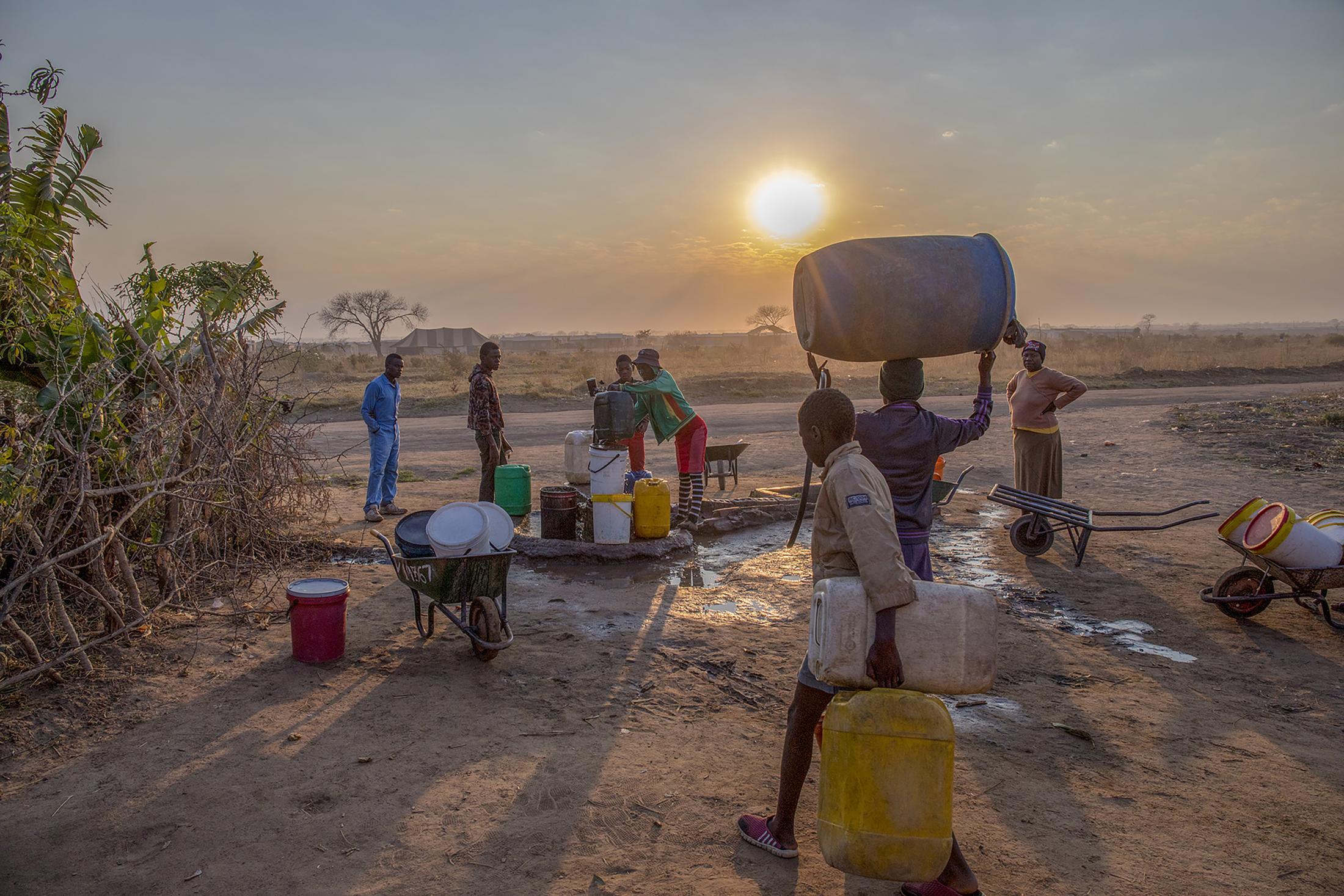 Residents of Empopini queue up for water in the southwestern city of Bulawayo, Zimbabwe. Cynthia Matonhodze for Bloomberg.