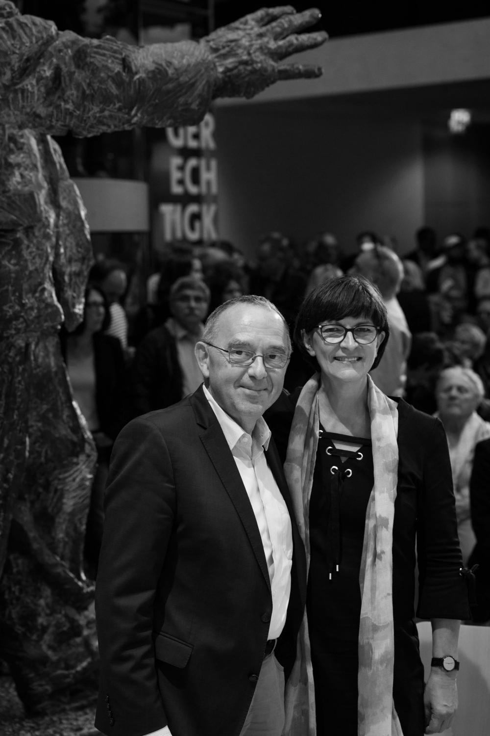 Norbert Walter-Borjans and Saskia Esken stand next to the statue of Willy Brandt at one of the debates for party leadership of the Social Democratic Party of Germany SPD on September 17, 2019 in Berlin. The two left-wingers started as underdogs, but were later elected by the party base and have been leading the party since December 2019.
