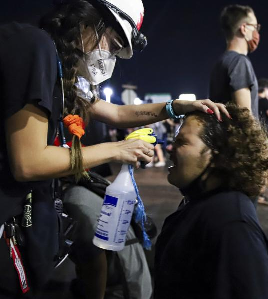 Protesters return to Ferguson on the 6th anniversary of the Micheal Brown Jr. shooting on Sunday, August 9, 2020, in front of the Ferguson Police Department. Samantha Waigand/Missourian