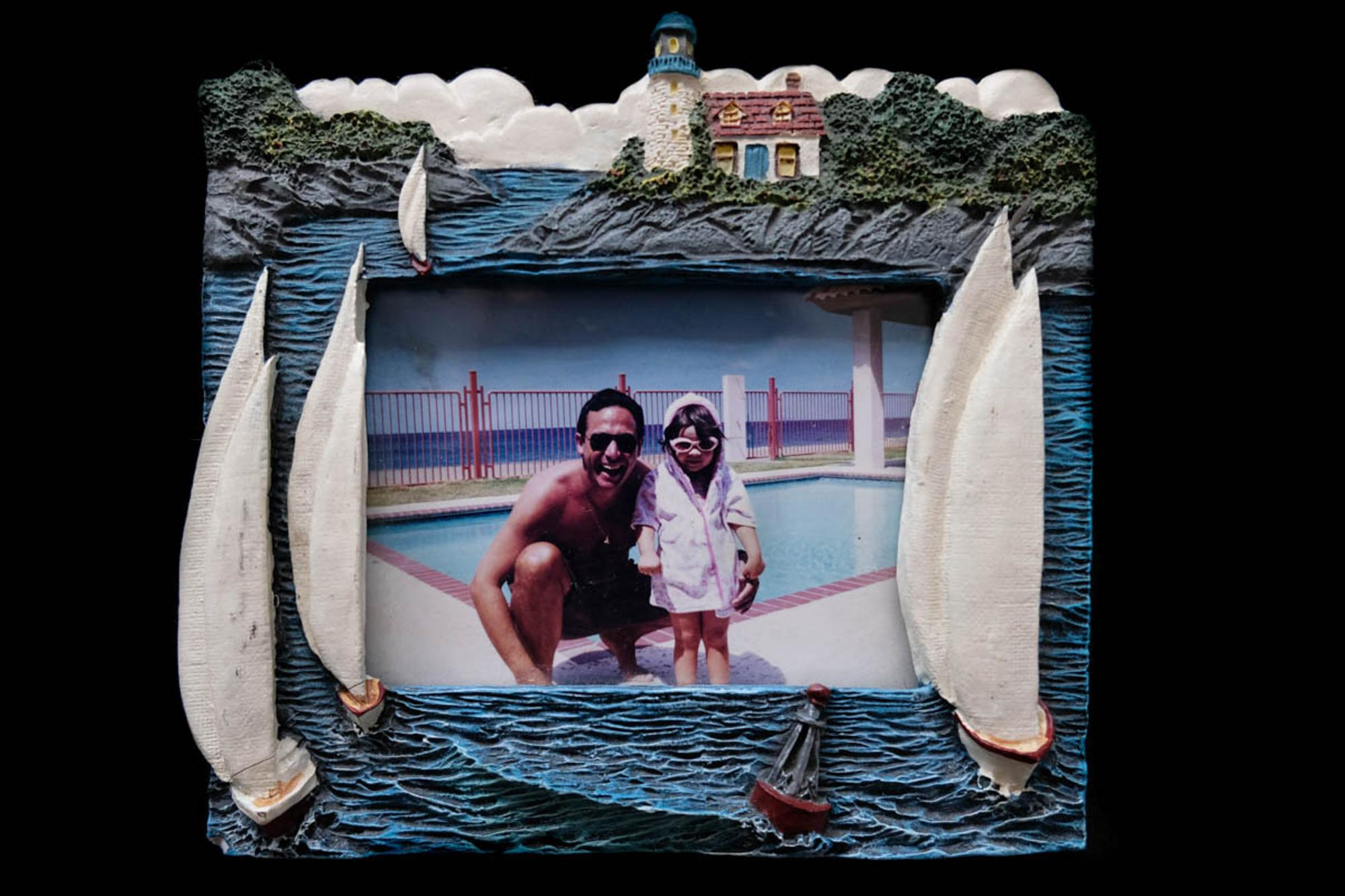 The first photograph taken for this project is of the first item that was given to me after my father's funeral. My father loved the ocean and had several picture frames that made reference to it. In this image we are at a apartment complex at Rincón, Puerto Rico, here he would spend the whole day at the beach and in the water. Gabriella N. Báez (@gabriellanbaez) is a documentary photographer and visual artist based between San Juan, Puerto Rico and New York City. Early in her career, she has focused on documenting intimate subjects: from her father's death post-Hurricane María, the archives of her Cuban family, and the relationship between sexuality and depression. Her work is raw, intimate, and personal. She has been published in Reuters, Bloomberg, The New York Times, The Guardian, CNN, BuzzFeed News, and The Washington Post. She is currently a 2020 Magnum Foundation Photography and Social Justice Fellow.