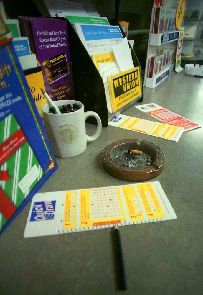 Quick Draw cards and a cigarette bud on the counter.