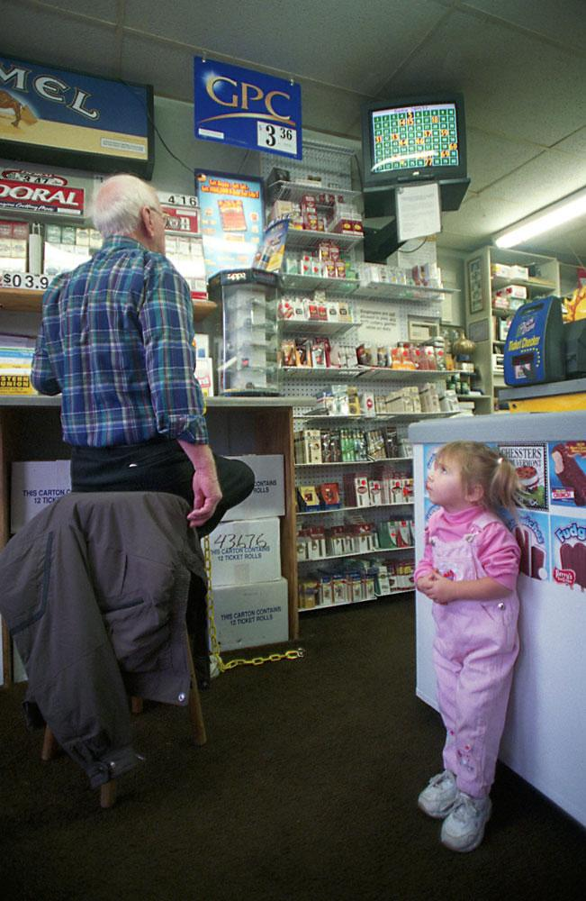 Jennifer Fantacone, 2,stares at one of betting customers.
