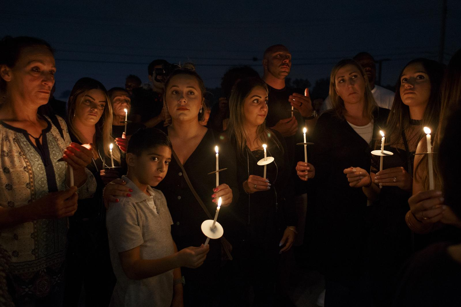 Community members share a moment of silence at a vigil to remember Jimmy Al-Daoud on Thursday, Aug. 15, 2019 at the Chaldean Community Foundation in Sterlings Heights. Al-Daoud, of Detroit, was found dead in Iraq earlier this month after he was deported.