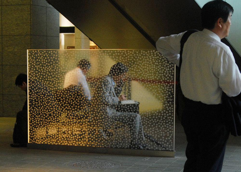Japanese business men taking an afternoon break at Marunouchi Oazo center, Tokyo.