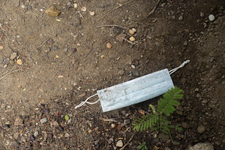 GUARENAS, VENEZUELA - JULY 12, 2020 A surgical mask left on the ground in the park near Julieth's apartment complex. CREDIT: Lexi Parra