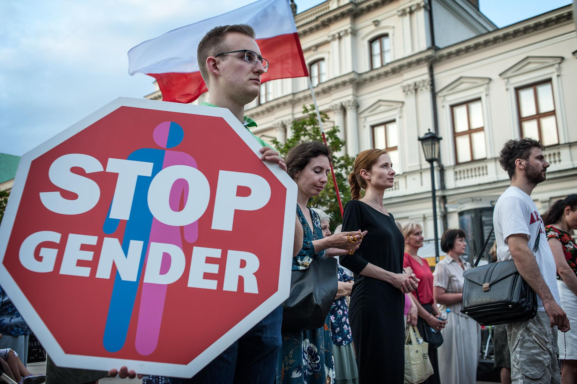 """Photo 2: Public prayer against the """"gender ideology"""" and to apologize for the sin of sodomy. These types of prayers are organized in several cities in Poland by private religious associations and foundations with the support and participation of the Catholic Church. / Warsaw, city center, 2019."""
