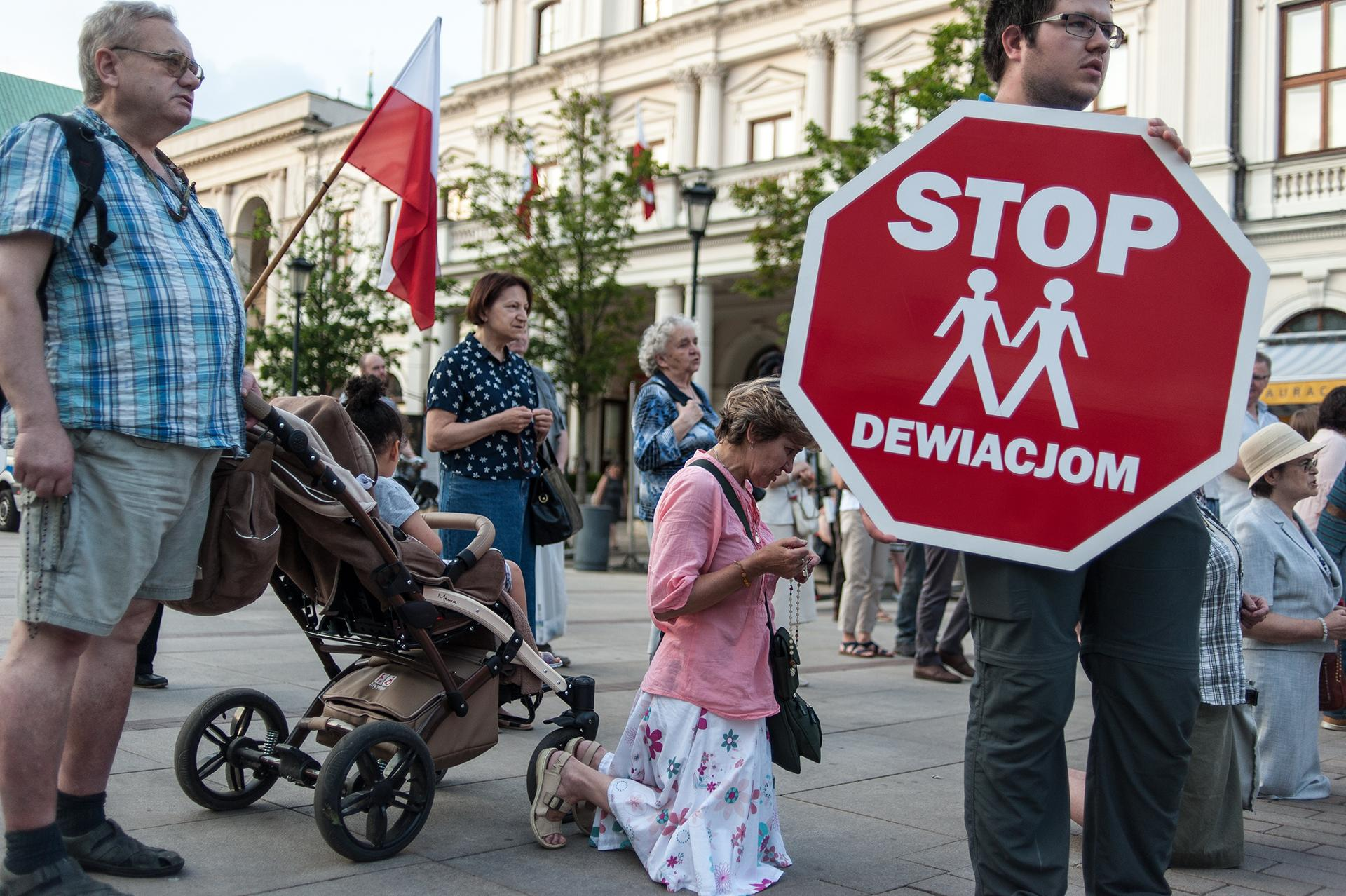 """Photo 3: Public prayer against the """"gender ideology"""" and to apologize for the sin of sodomy. These types of prayers are organized in several cities in Poland by private religious associations and foundations with the support and participation of the Catholic Church. / Warsaw, city center, 2019."""