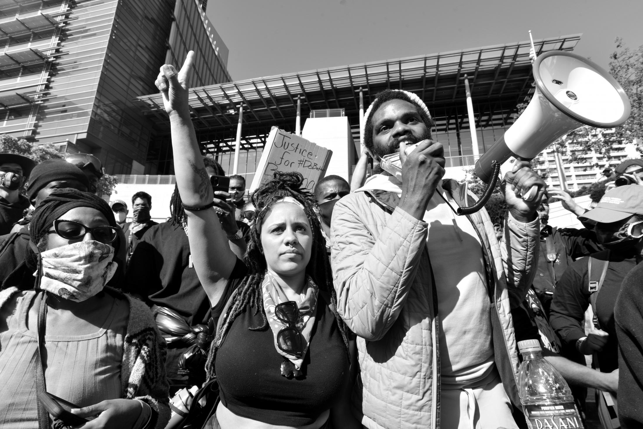 Leading activists give speeches outside of City Hall in downtown Seattle after the protest was followed by the National Guard.