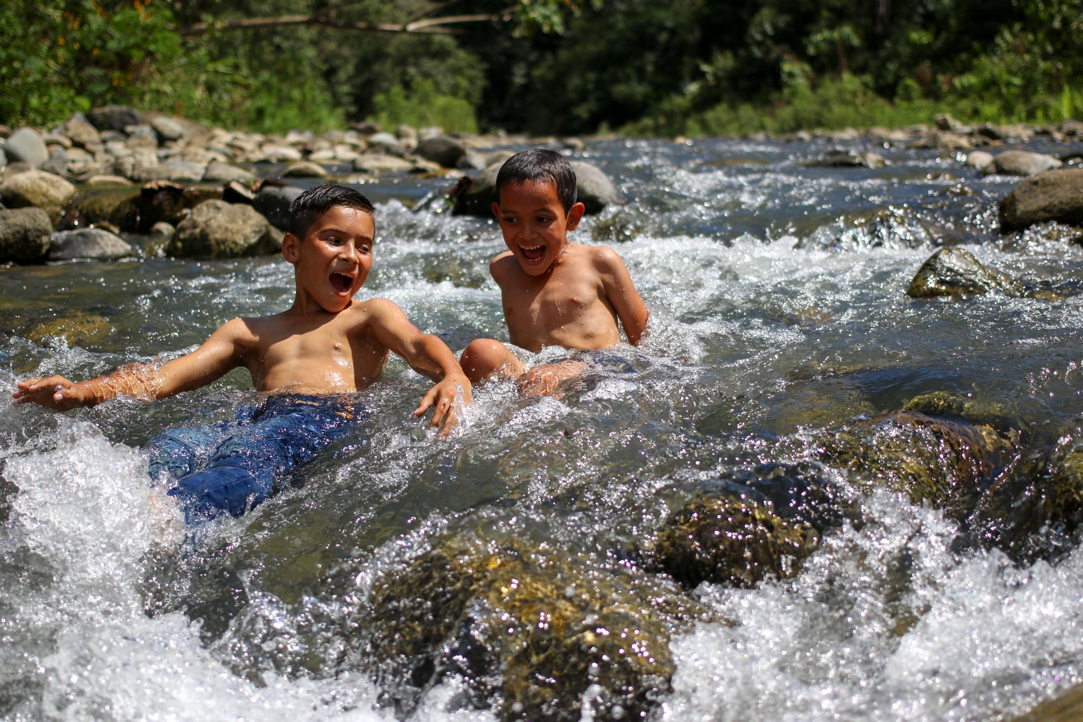 Rivers are as important as the forest themselves. Rio Tigre river where these kids are having fun used to be heavily mined for gold. It runs from the heart of Corcovado National Park into the ocean. Thanks to heavy protection and strong conservations work from the Community of Rio Tigre, gold mining has decreased. and the river is recovering.