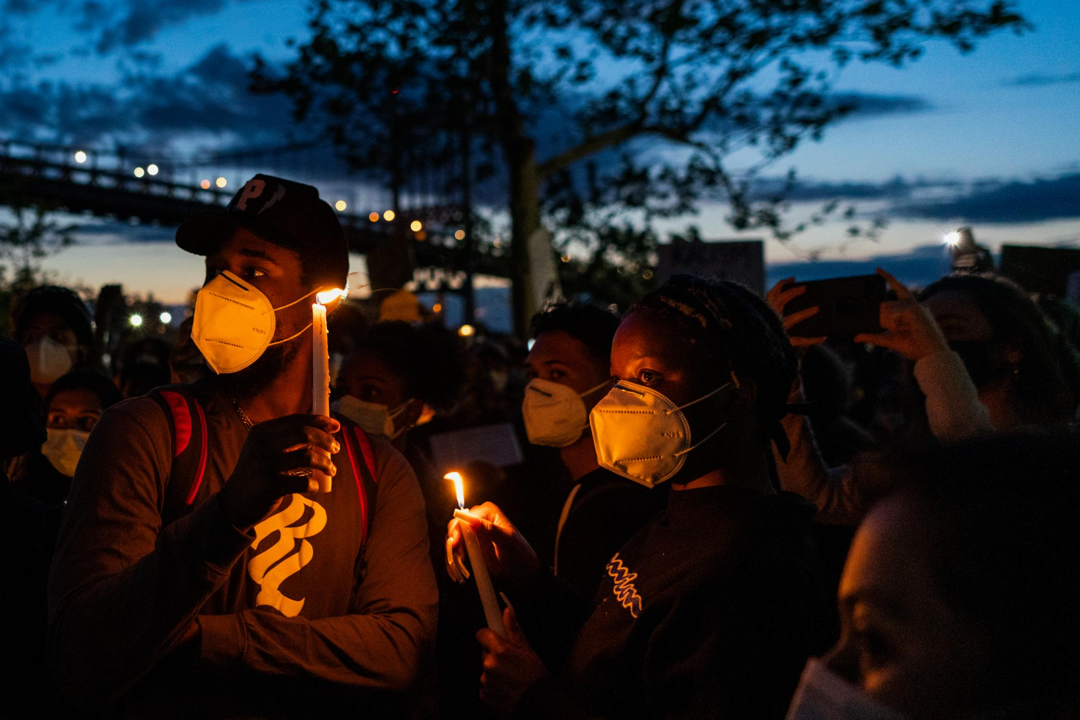 Vigil attendees hold candles and listen to New Yorkers give speeches and share testimonials during a vigil for George Floyd on Monday, June 2020 in Astoria, New York.