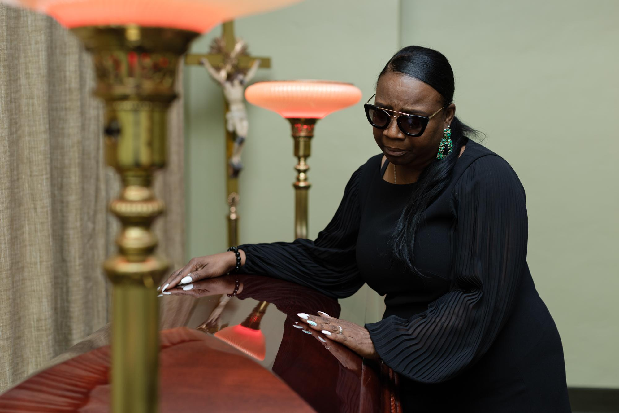 Day #4. Ms. Gail Roberson mourns the loss of her son at a chapel at Duggan's Funeral Service on Friday, March 20, 2020, in San Francisco, Calif. When one loses loved ones, family and friends support is essential, but in an attempt to stop the further spread of COVID-19, Duggan's Funeral Service in San Francisco has had to limit funeral services to less than 10 people, and only three visitors can come inside the funeral home at once to make arrangements and attend a wake. - On assignment for San Francisco Chronicle.