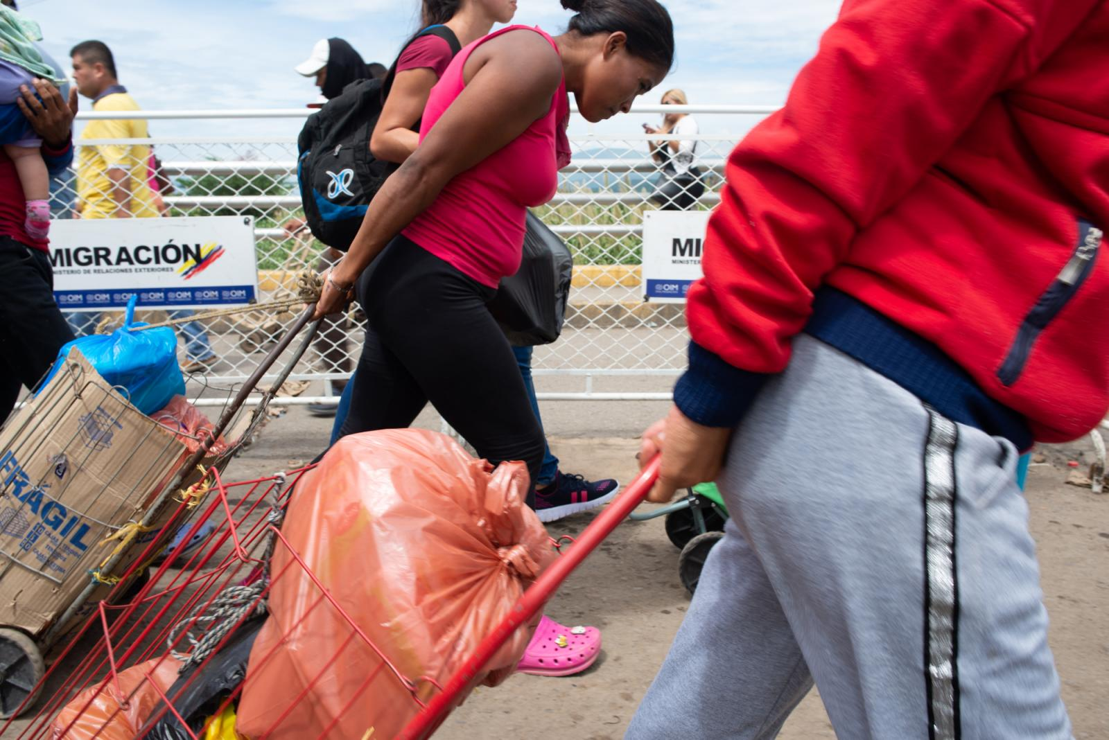 Zully (left) and Nelly (right), best friends and working partners as Garrucheras, are carrying goods for a client from Colombia to Venezuela. La Parada, Colombia - October 10, 2019.