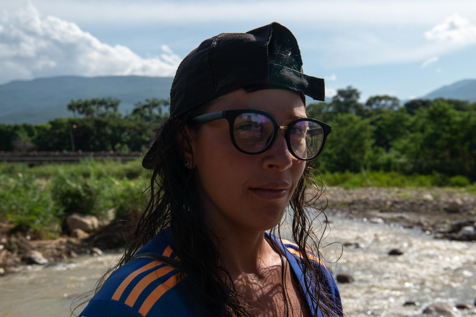 """Nelly is 22 years old and originally from Caracas, Venezuela. She migrated to Colombia a little over a year. Formal work is hard to find so she decided to work as a Garruchera transporting goods between the Venezuelan - Colombian border. """"Fight for your dreams and prove that you can,"""" Nelly says. """"The female gender can, and we can show that we're warriors."""" La Parada, Colombia - October 6, 2019."""