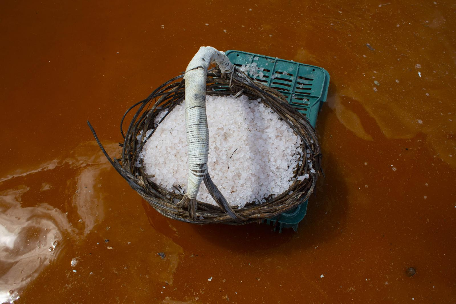 Detail of a basket with product during the salt harvest in a pond in Xtampú, Yucatan, Mexico, on Saturday, October 26, 2019. Photographer: Koral Carballo/Bloomberg