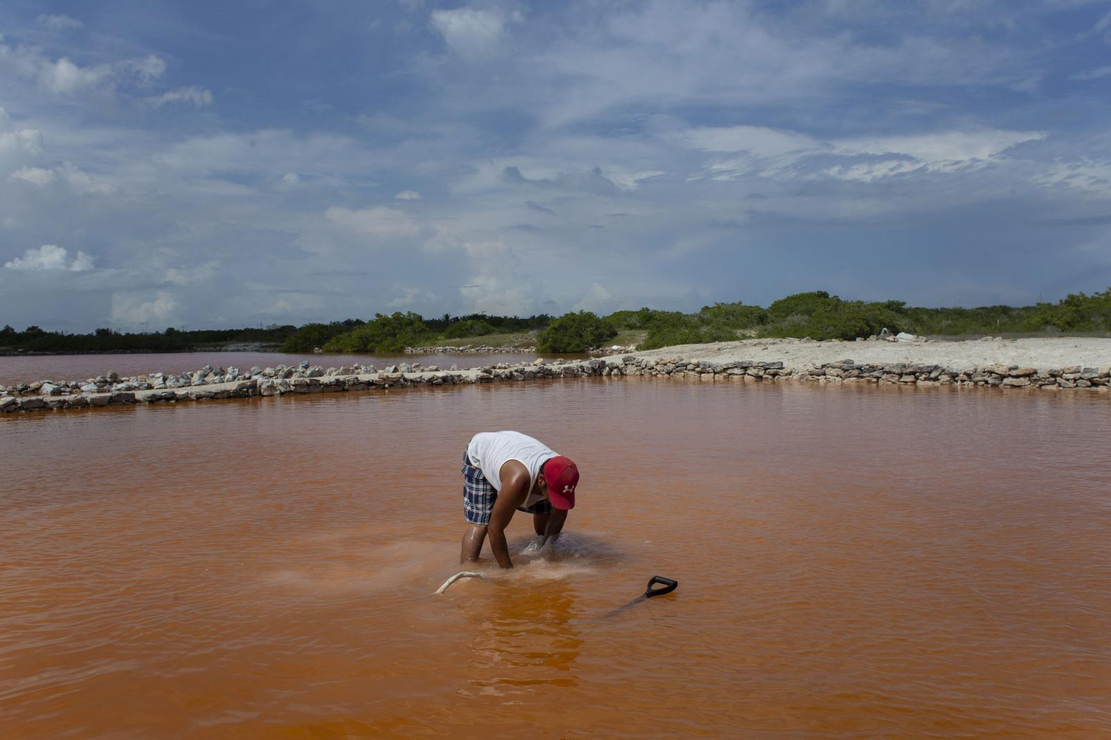 A worker harvest salt in  Xtampú, Yucatan state, Mexico, on Saturday, Oct. 26, 2019. Photographer: Koral Carballo/Bloomberg