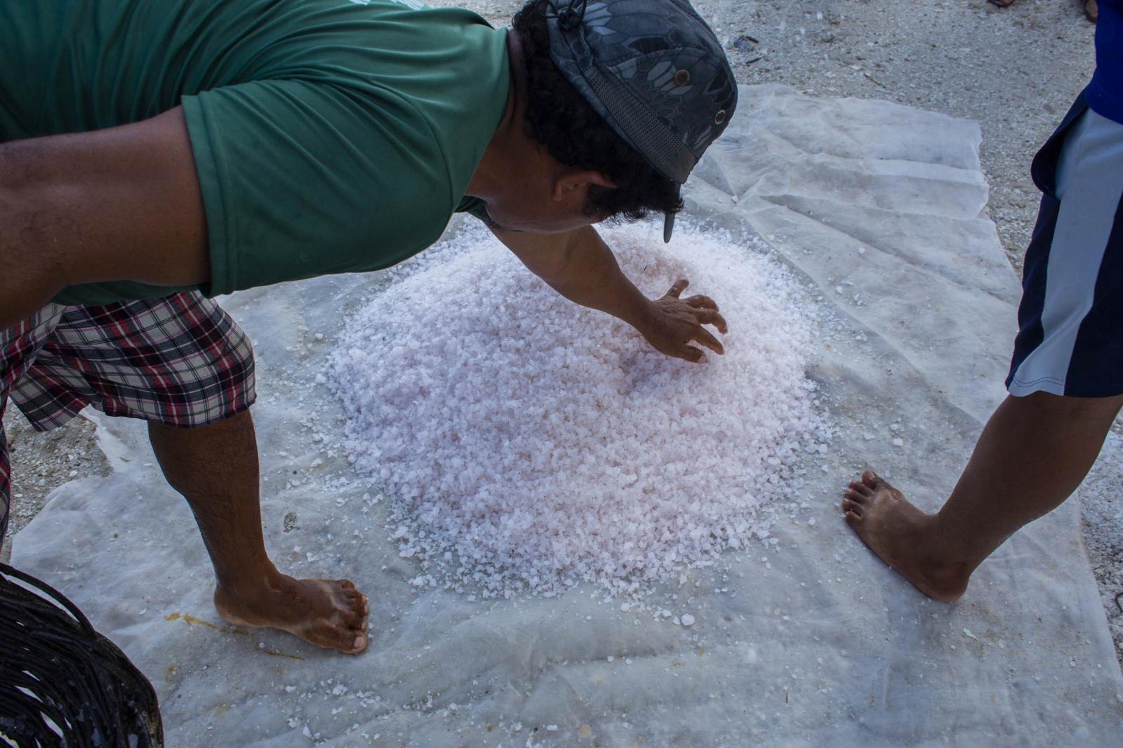 Workers during the salt harvest inside a pond in Xtampú, Yucatán state, Mexico, on Saturday, October 26, 2019. Photographer: Koral Carballo/Bloomberg
