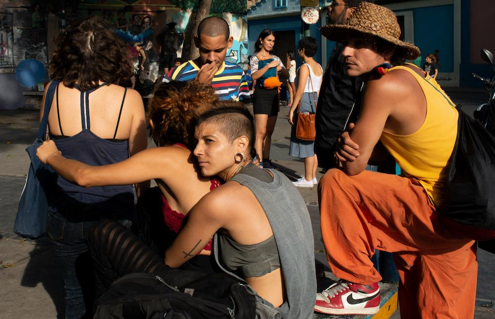 CARACAS, VENEZUELA - JUNE 2, 2019 A group of university students wait for an outdoor rock concert to start in Catia, a western area of the city.