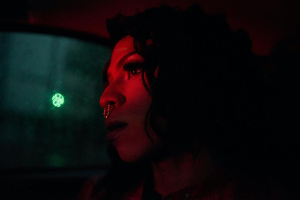 CARACAS, VENEZUELA - JULY 30, 2019. Daniel, dressed as Miranda, in a cab on the way to the drag club in Altamira, an affluent part of the city. Credit: Lexi Parra