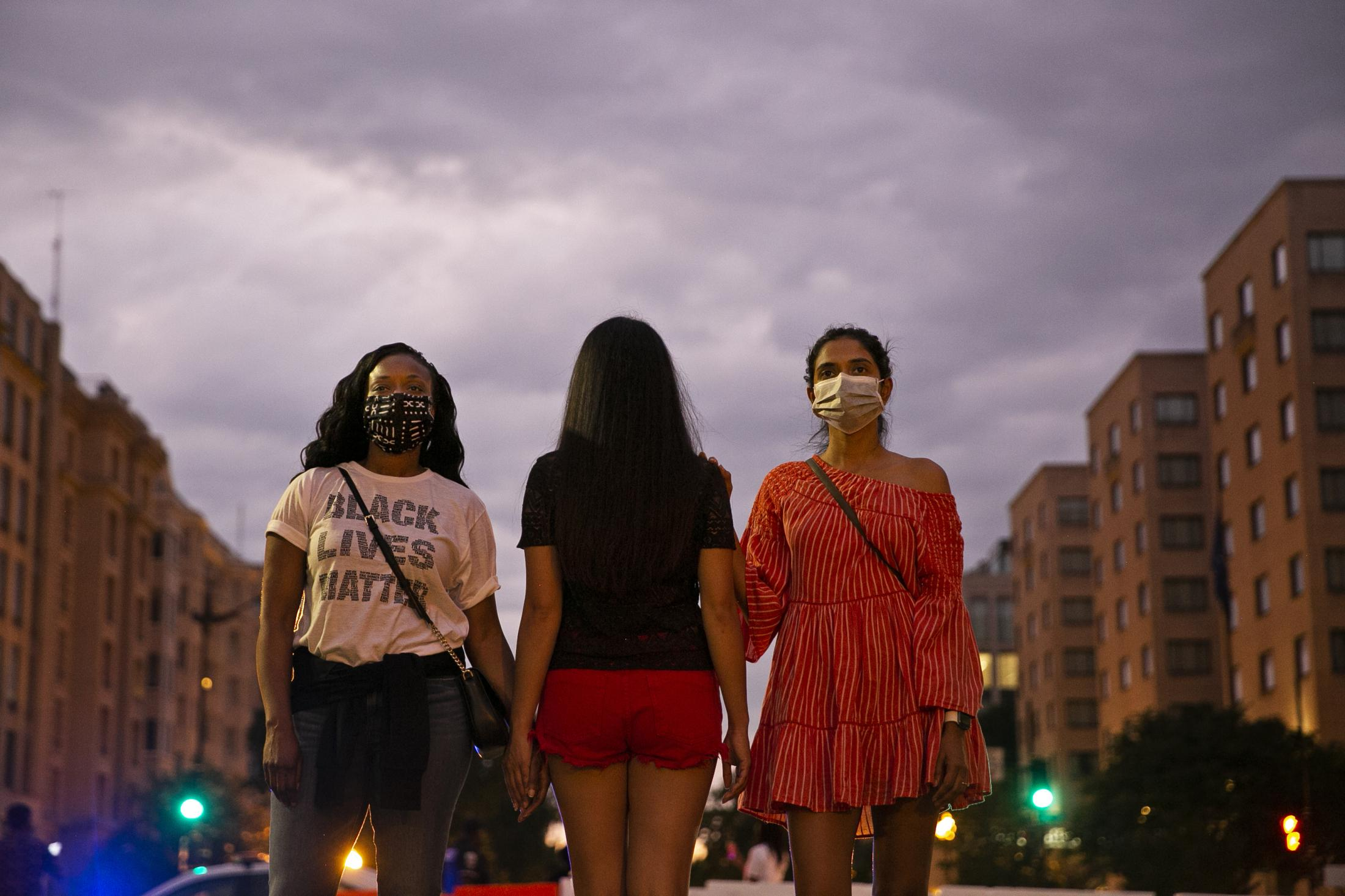 """Tamara (left), 39, comes to the protests with her friend Preethy (right) and their Vietnamese American friend who is not willing to identify herself. """"As an immigrant, we all face some levels of discrimination, but I don't think it would ever come up to the level of racism that Black people face,"""" Preethy says, """"It is important for us to stand up for that as part of the community and a lot of legal reform is needed right now."""" Tamara expresses her concern that the killing of George Floyd could have happened to her brother and uncle. """"It meant a lot to me my friends are supportive and invite me out,"""" Tamara says, """"As an African-American woman, it is really nice to have the support of people who are not Black, it warms my heart to have them support me."""""""