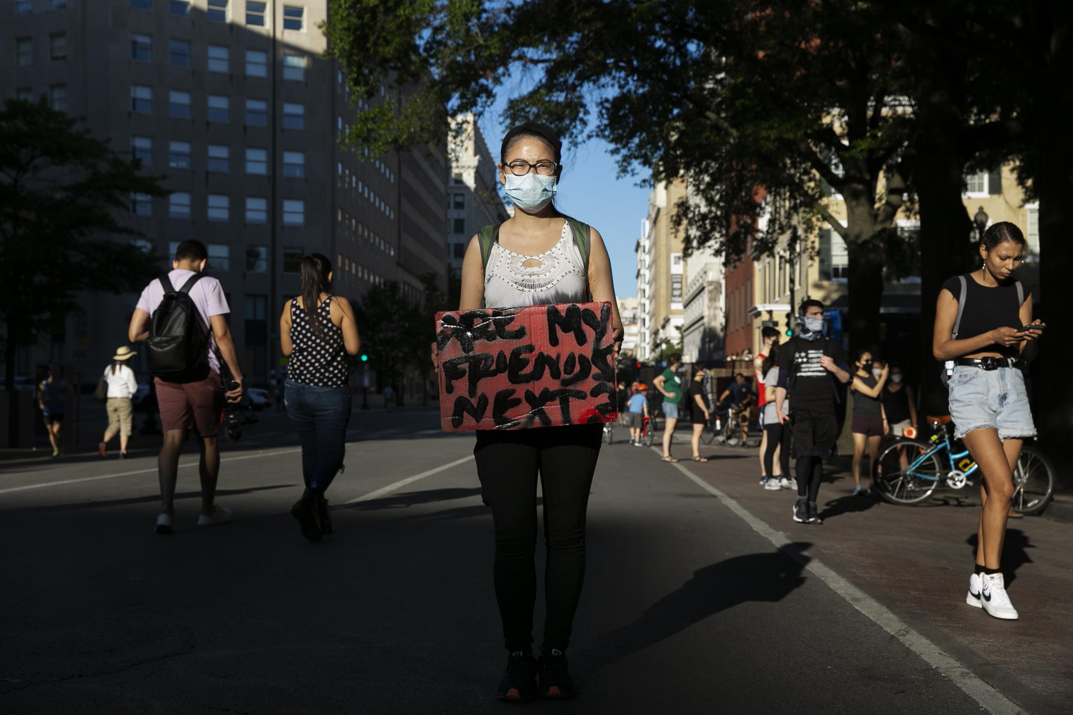 """Intensive Care Unit nurse and a resident of Northern Virginia, Vivian Dang, 28, has been part of the protests for eight to 12 hours every day. She has seen both sides of racism with the COVID-19 towards Asian Americans and the killing of George Floyd. It is difficult for her to see the country still battling with racism in 2020 when she listens to speeches by protestors at the Lincoln Memorial where Martin Luther King Jr. delivered his """"I have a dream"""" speech decades ago. """"A big part of me just wants everyone to be treated equally and have equal access to health care,"""" Vivian says."""
