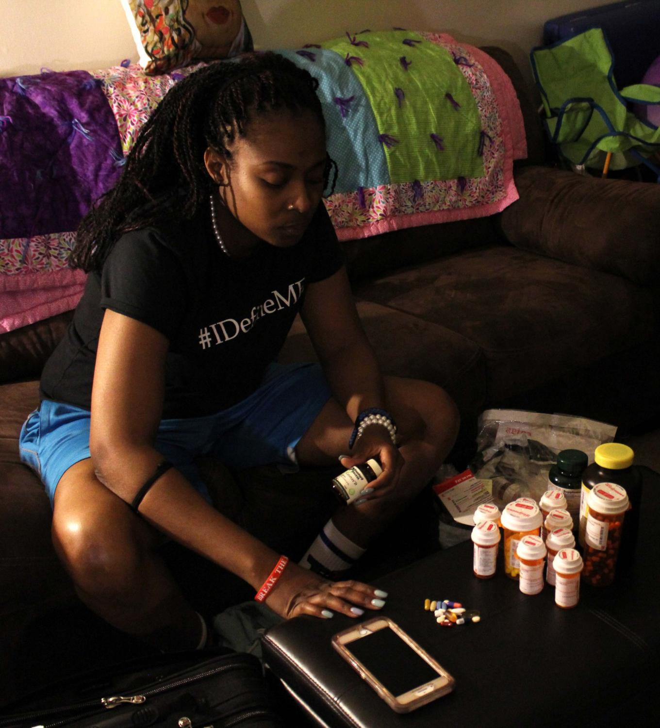 Ronicia Otey, a 28-year-old graduate student at Lincoln University in Jefferson City, Missouri, with Sickle Cell Disease Type SS, lays out her nightly medication on April 7, 2019, at her apartment in Saint Louis. Sickle Cell Type SS is where a person's body produces more sickle-shaped red blood cells than regular ones, causing chronic pain. As part of her treatment, Otey had to take 22 different pills before going to bed every night, not including the ones for pain management.